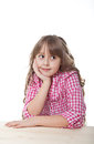Portrait of smiling girl the sitting at a table isolated over white Royalty Free Stock Photo