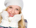 Portrait of smiling girl in winter clothes isolated on white Royalty Free Stock Photo