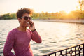 Portrait of a smiling guy using mobile phone. Royalty Free Stock Photo