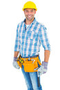 Portrait of smiling handyman wearing tool belt Royalty Free Stock Photo