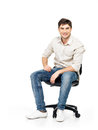 Portrait of smiling happy man sits on office chair the isolated white Stock Photo