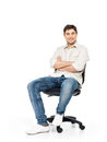 Portrait of smiling happy man sits on office chair the isolated white Stock Photography