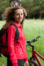 Portrait of smiling happy woman cyclist Stock Photography