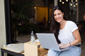 Portrait of a smiling hipster girl using laptop computer with copy space area for your text message or advertising content Royalty Free Stock Photo