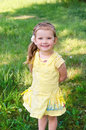Portrait of smiling little girl in dress outdoor Stock Image