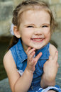 Portrait of smiling little girl in dress outdoor Stock Photography