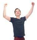 Portrait of a smiling man with arms raised in success isolated on white background Stock Images