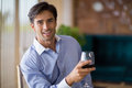 Portrait of smiling man holding glass of red wine Royalty Free Stock Photo