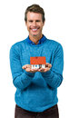 Portrait of smiling man holding model house Royalty Free Stock Photo