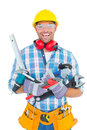 Portrait of smiling manual worker holding various tools Royalty Free Stock Photo