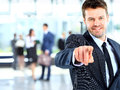 Portrait of smiling mature business man pointing at you in office Royalty Free Stock Photos