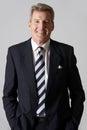 Portrait of smiling mature businessman studio Stock Photos