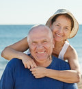 Portrait of smiling mature couple at sea vacation Royalty Free Stock Image