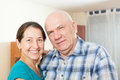 Portrait of smiling mature couple together in home interior Stock Photos