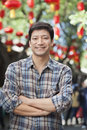 Portrait of smiling mid adult man with arms crossed in nanluoguxiang beijing Stock Photography