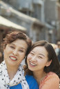 Portrait of smiling mother and daughter on the street in beijing close up Royalty Free Stock Photos