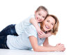 Portrait of smiling mother and young daughter happy white lying on the floor isolated happy family people concept Royalty Free Stock Image