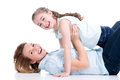 Portrait of smiling mother and young daughter happy white lying on the floor isolated happy family people concept Stock Images
