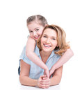 Portrait of smiling mother and young daughter happy white lying on the floor isolated happy family people concept Royalty Free Stock Photography