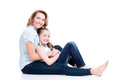 Portrait of smiling mother and young daughter happy white lying on the floor isolated happy family people concept Stock Image