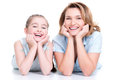 Portrait of smiling mother and young daughter happy white lying on the floor isolated happy family people concept Stock Photography