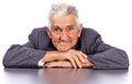 Portrait of a smiling old man looking at camera against white background Royalty Free Stock Photography