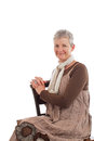 Portrait of smiling older woman sitting sideways Royalty Free Stock Photo