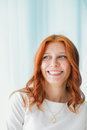 Portrait of smiling red haired woman in home Royalty Free Stock Photography