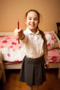Portrait of smiling schoolgirl holding red pencil blurred Stock Photography