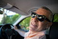 Portrait of smiling senior man wearing sunglasses in car Royalty Free Stock Photo