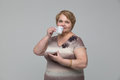 Portrait of smiling senior woman drinking tea