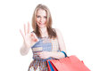 Portrait of smiling shopper with paper bags showing ok sign Royalty Free Stock Photo