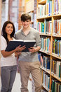 Portrait of smiling students holding a book Royalty Free Stock Photo