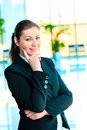 Portrait of smiling successful business people on the background a blurred office interior Royalty Free Stock Images