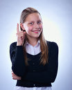 Portrait of a smiling teen girl with finger up studio shot Royalty Free Stock Photography