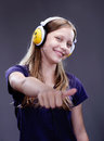 Portrait of a smiling teen girl with headphones studio shot Stock Image