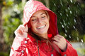 Portrait of smiling teenage girl enjoying the rain Stock Photography