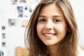 Portrait Of Smiling Teenage Girl At Home Royalty Free Stock Photo