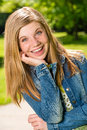 Portrait of smiling teenage girl outside in the sunshine Royalty Free Stock Photo