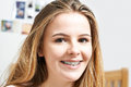Portrait Of Smiling Teenage Girl Wearing Dental Braces Royalty Free Stock Photo