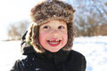 Portrait of smiling toddler walking in winter outdoors Royalty Free Stock Photo