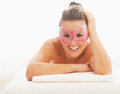 Portrait of smiling woman in eye mask laying on massage table young Royalty Free Stock Photo