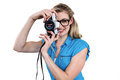 Portrait of smiling woman holding digital camera Royalty Free Stock Photo