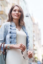 Portrait of smiling woman with long hair wearing casual clothes Royalty Free Stock Photo
