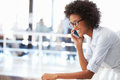 Portrait of smiling woman in office talking on phone women Royalty Free Stock Image
