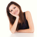 Portrait of smiling woman resting her chin on hand white background Stock Photography