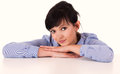Portrait of smiling woman resting her chin on hands white background Royalty Free Stock Photo