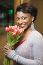 Portrait of Smiling Woman With Tulips Royalty Free Stock Image
