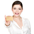 Portrait of smiling woman in a white shirt with credit card business holds the isolated on Royalty Free Stock Image
