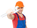 Portrait smiling worker big spanner isolated white background Royalty Free Stock Images